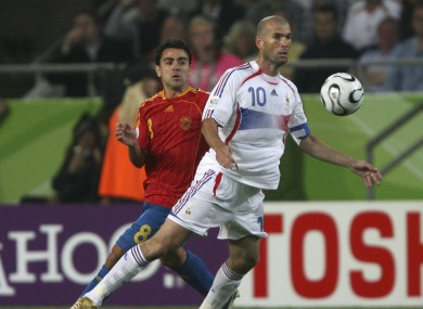 Zidane with Xavi on his back.