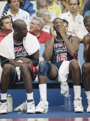 Magic Johnson, right, laughs heartily as Michael Jordan jokes during the Barcelona Olympics.