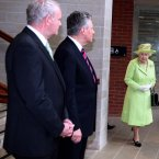 Queen Elizabeth II arrives to meet Northern Ireland First Minister Peter Robinson (centre) and Deputy First Minister Martin McGuinness (left) at the Lyric Theatre in Belfast. (Paul Faith/Photocall Ireland/PA Images)