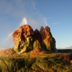 Located on private property, every year a select bunch of scientists and photographers are allowed access to view the Fly Geyser in Gerlach, Nevada. It's not entirely a natural phenomenon - it was accidentally created during the drilling of a well in 1916, after which geothermal water began to escape to the surface and build up a tower of minerals through which the water spouts.  Image: Ken Lund/Flickr.com