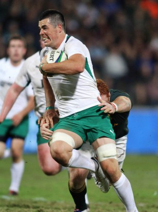 Ireland's Jordan Coghlan breaks Steven Kitshoff's tackle to run in for a try in Monday's game.