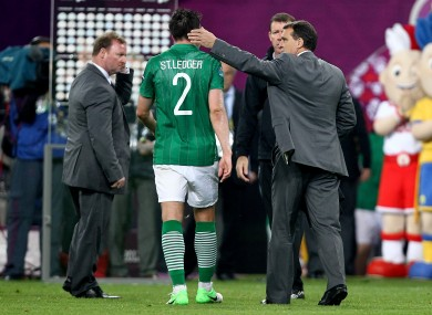 Marco Tardelli consoles goalscorer Sean St Ledger after Sunday night's defeat in Poznan.