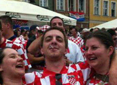 Shirts off for the Boys in Green: Jelena and Viktorija were also snapped with a Croatian fan in Poznan's main square.