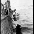 Frank Hurley washing cinematograph film on the Aurora during the first Australasian expedition to Antarctica.