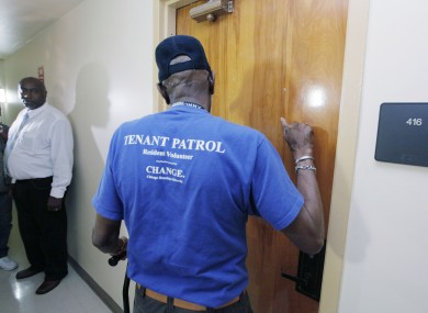 A tenant patrol volunteer makes a well-being check on a tenant at The Chicago Housing Authority's Apartamentos Las Americas