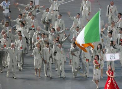 Ciara Peelo leads the Irish team around Beijing's Olympic Stadium.
