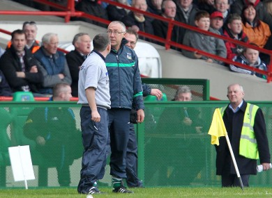 Limerick's John Allen and  and Davy Fitzgerald of Clare argue on the sideline during their match in April.