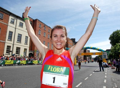 Linda Byrne celebrates winning the 2012 Flora Women's Mini Marathon.
