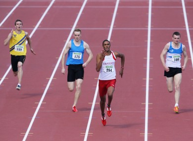 Stephen Colvert, second from right, powers clear to win the men's 200m title.