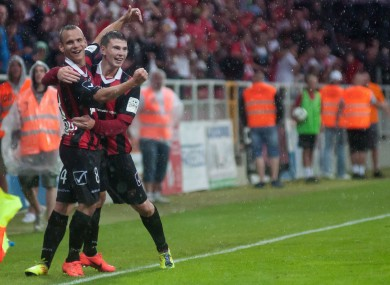 Martin Mikovic is congratulated by Michal Habanek after scoring.