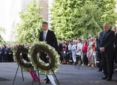Norwegian King Harald, right, and Prime Minister Jens Stoltenberg, center, attend a memorial ceremony for the victims.