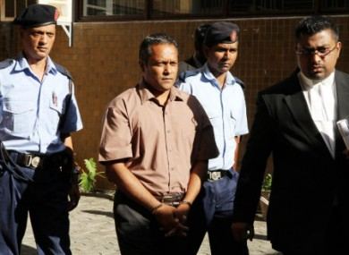 Sandip Mooneea arrives at the Supreme Court in Port Louis, Mauritius.