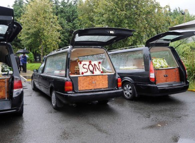 The three hearses carrying the coffins of the Doyle brothers.