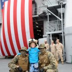 US Marines Christopher Hardin (left) and Zachary Snipes pose with 8-year-old Jonathan Erickson who was taking a tour of the USS Fort McHenry. (Photo: Laura Hutton/Photocall Ireland)