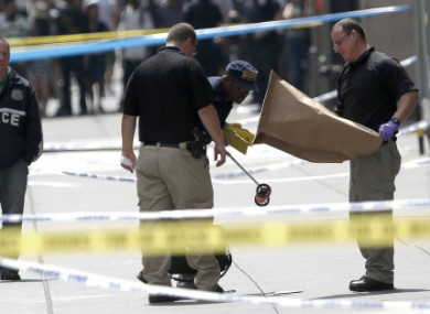 Police collecting evidence at the scene of yesterday's shooting.