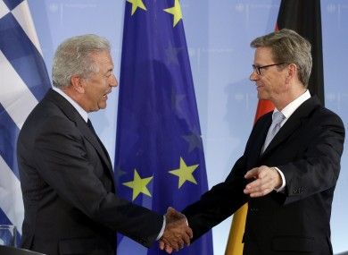 Greek foreign minister Dimitris Avramopulos (left) shakes hands with his German counterpart Guido Westerwelle after a meeting in Berlin today.