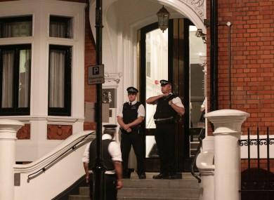 Police officers outside the Ecuadorian Embassy in central London last night.