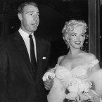 With Joe DiMaggio (her second of three husbands), as she arrives at the theatre on 2 June 1955. (AP Photo, File)