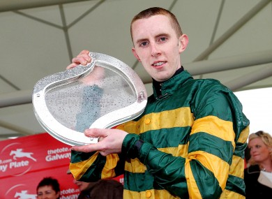 Mark Walsh with the Galway Plate after winning on Bob Lingo at the Galway Festival yesterday.
