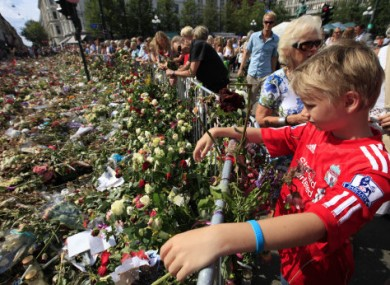 1 August 2011: Floral tributes to the victims of the two attacks are left outside Oslo Cathedral.