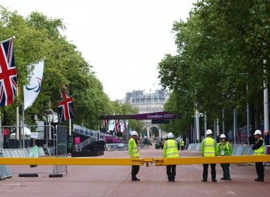Workmen on the closed off Mall, as last minute preparations are made for the Paralympics.