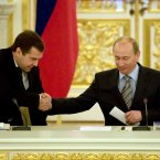 The gold-trimmed surroundings don't really distract from the awkward body language of this hunched-handshake between Russian President Vladimir Putin and then-First Deputy Premier Dmitry Medvedev in 2008. (AP Photo/Alexander Zemlianichenko, Pool)