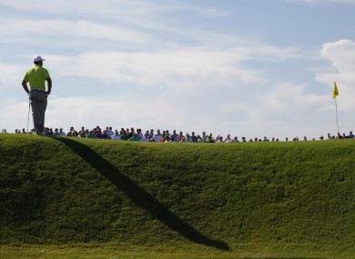 Tiger Woods waits his turn on the 14th yesterday.