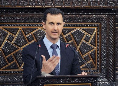 Syrian President Bashar Assad delivers a speech at the parliament in Damascus in June.