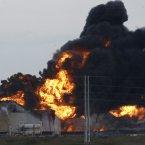 Fire rises over the Amuay refinery near Punto Fijo, Venezuela, yesterday. (AP Photo/Ariana Cubillos/PA)