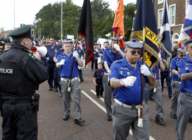 Members of the Royal Black Institution defied a Parades Commission recommendation not to play music outside a Catholic church along its parade route.