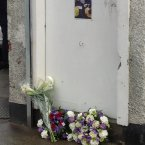 A photo of the two Bray firemen is tacked to the front door where they perished. (Photo via Christina Finn)
