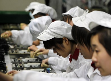 A file photo of workers on an assembly line at a Foxconn plant in Shenzhen, China.
