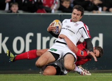 Jared Payne of Ulster is tackled by Munster's Ian Keatley.
