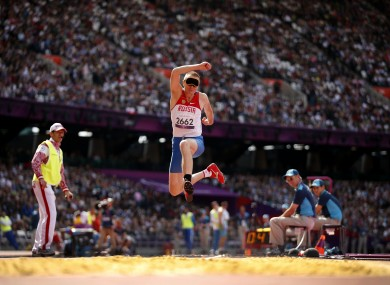 Russia's Denis Gulin jumps in the men's F11 triple jump.