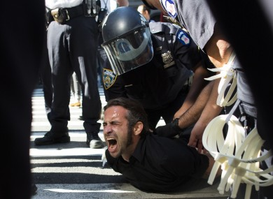 Occupy Wall Street protestor Chris Philips screams as he is arrested near Zuccotti Park today.