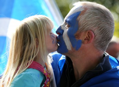 Scottish Independence supporters Alec and daughter Lena Forbes from Wick attend a rally for Scottish Independence in Princess Street Gardens, Edinburgh.
