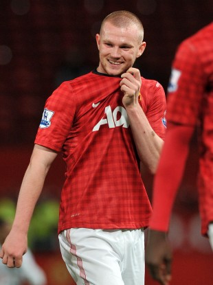 Ryan Tunnicliffe smiles as he leaves the Old Trafford pitch.