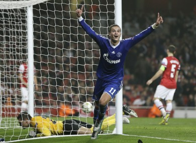 Schalke 04's Ibrahim Afellay of the Netherlands celebrates after scoring a goal against Arsenal. Schalke won 2-0.