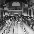 This is a 1924 photo of the registry room at Ellis Island in New York harbour.
