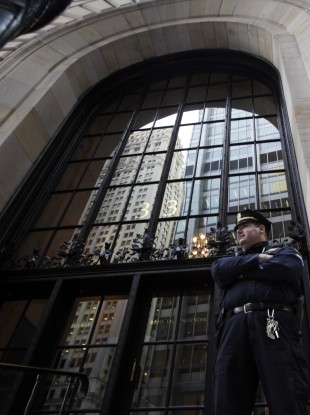 A Federal Reserve police officer guards the building in New York today.