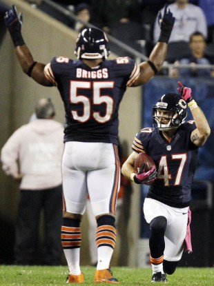Bears safety Chris Conte (47) celebrates with linebacker Lance Briggs (55) after intercepting a pass in the second half.