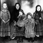 A Hungarian mother and her four children pose after their arrival in 1909 at the island. (AP Photo/National Park Service/Statue of Liberty National Monument)