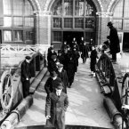 Another side to the island: People who have been arrested in the federal drive against radicals are shown as they arrive at Ellis Island 7 April, 1920. Deportation hearings are held on the island to determine whether they are to stay in the United States. (AP Photo)
