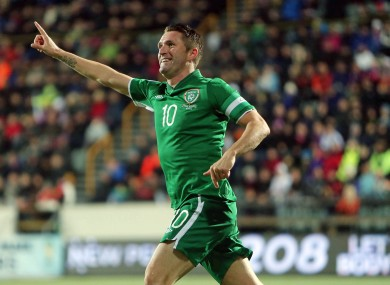Robbie Keane tries to claim the goal that was later awarded to strike partner Jon Walters.