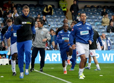 Queens Park Rangers' Anton Ferdinand (right) opted not to wear an anti-rascism t-shirt during pre-match training last week.