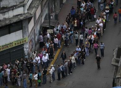 People line up to vote in Caracas in Venezuela today