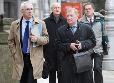 Irish Aid officials arrive at Leinster House to answer questions from the Committee on Foreign Affiars and Trade relating to the misappropriation of funds.