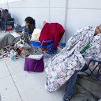A woman sits, wrapped in a blanket, outside a Pembroke Pines in Florida. (AP Photo/J Pat Carter)