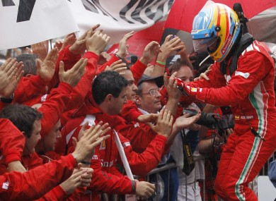 Fernando Alonso meets the team.