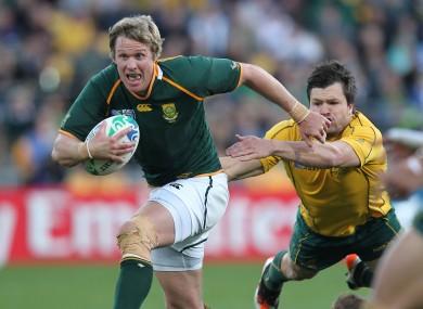Jean de Villiers evades Adam Ashley Cooper in the World Cup quarter-final.